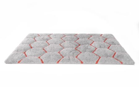 Furry carpet with honeycomb texture, isolated on white background. Interior element. 3d render 版權商用圖片