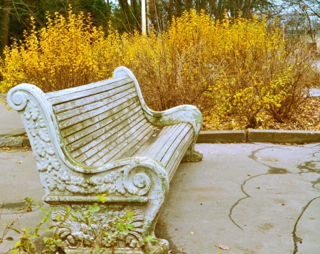 horisontal: Beautiful old bench in autumn park Stock Photo