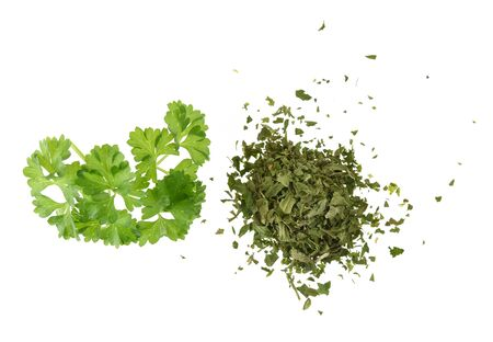 Fresh and pinch of dried parsley isolated on white background