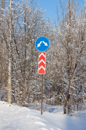 road signs on a snowy road