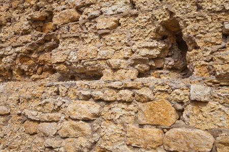 The old wall of natural stone Stock Photo