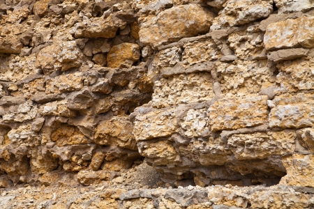 Stone wall of an old limestone Stock Photo