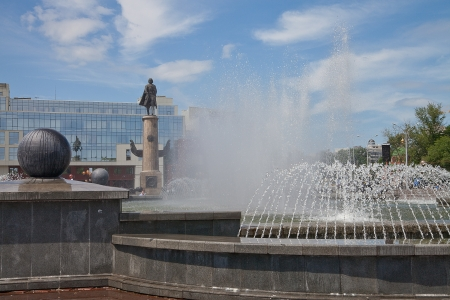 The fountain in the background of the monument and buildings