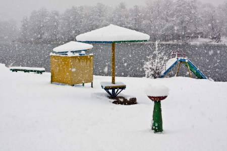 On the beach in the winter during a snowfall Stock Photo