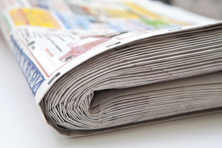 Stack of folded newspapers close-up photo