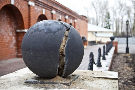 Chopped iron ball on a stand Stock Photo