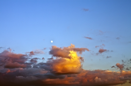 The moon and clouds in the evening sky