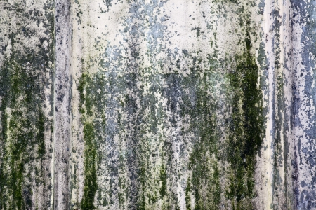 Old concrete wall with remnants of green paint Stock Photo
