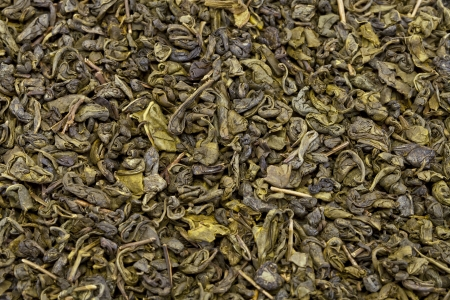 Dry green tea leaves, photographed close up
