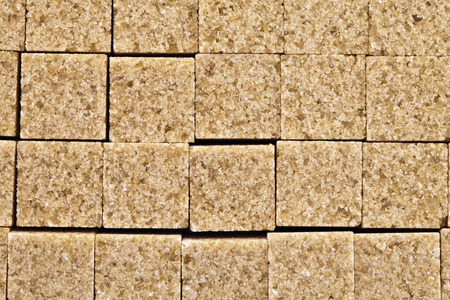 Pieces of brown cane sugar, photographed close up