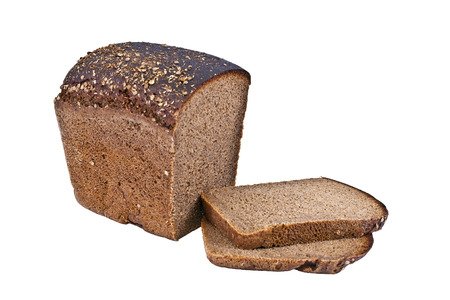 A loaf of rye black bread with cut pieces Stock Photo