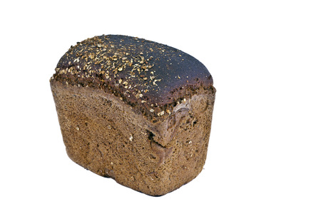 A loaf of rye bread, sprinkled with cumin, photographed close up Stock Photo