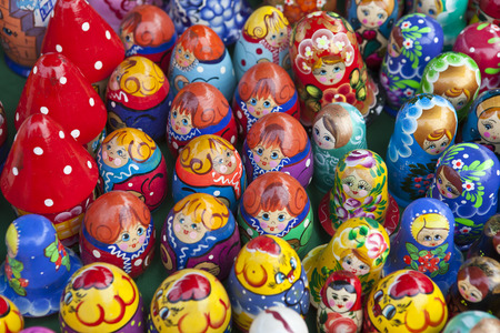Many small wooden dolls of different colors of wood