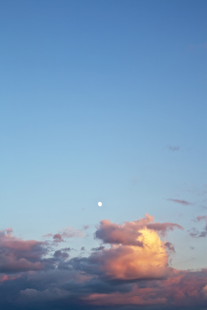 incomplete: Incomplete moon in the evening sky at sunset
