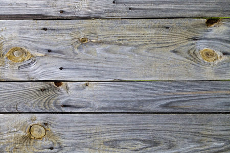 Wooden background from old pine boards with knots and nails