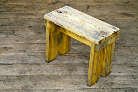 wooden bench: Wooden bench standing on the floor of pine boards Stock Photo