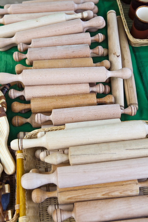 A lot of rolling pins made from different wood