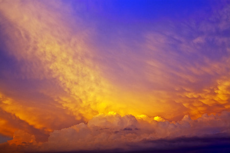Beautiful cumulus clouds and cirrus clouds in the evening sky Stock Photo