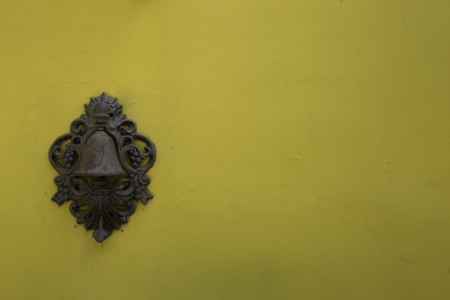 Service bell on yellow wall photo