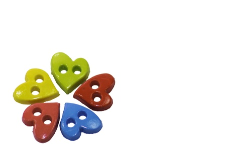 Colorful heart  button on white background photo