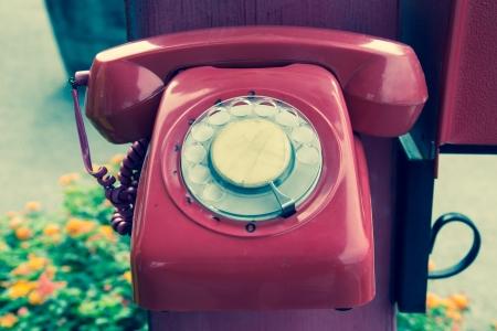 Retro Red Telephone hang on Pole photo