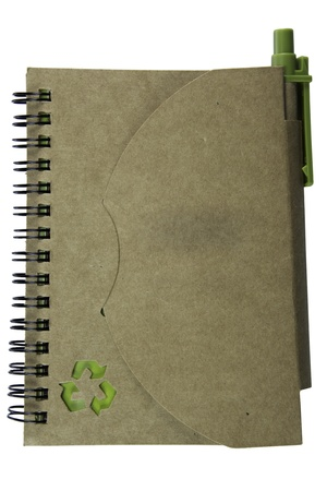 Recycled paper notebook and pen photo