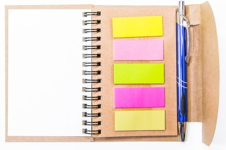 Colorful sticky notes in notebook photo
