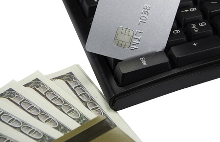 Money and credit cards on computer keyboard photo