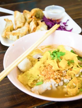 thai noodle soup: Thai Noodle Soup on wood table