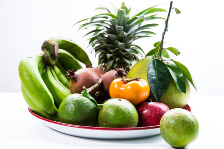 Platter of assorted fruit on white background photo
