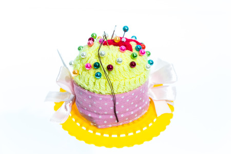 pinhead: Handmade pin cushion with multicolored sewing pins Stock Photo