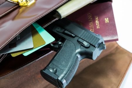 concealed: Card,passport and gun in Womans bag