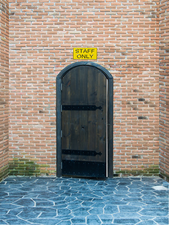 staff only: Wooden Door at entrance of staff only Stock Photo