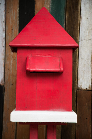 Wood Mail Box on the  wooden background photo