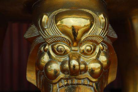 statuary garden: gold lion head