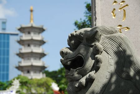 statuary garden: stone lion sculpture infront of the temple