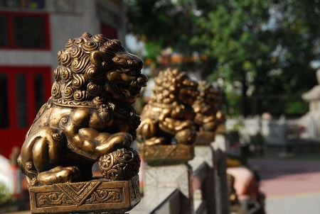 statuary garden: bronze lion in front of the temple
