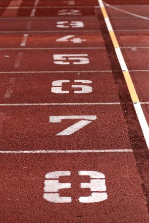 numbers marks on the tracks field in the stadium