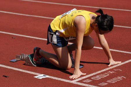 girl runner prepare to run at the sport centre  Stock Photo