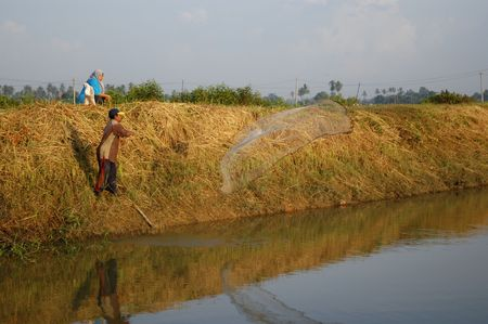 plough machine: farmer net fishing at the river side