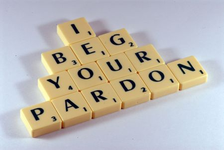 pardon: I beg your pardon letters on the table