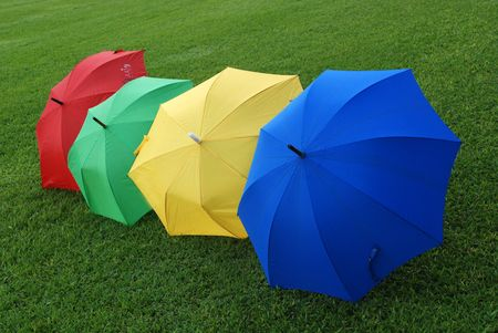 Colorful umbrellas on the football field  photo