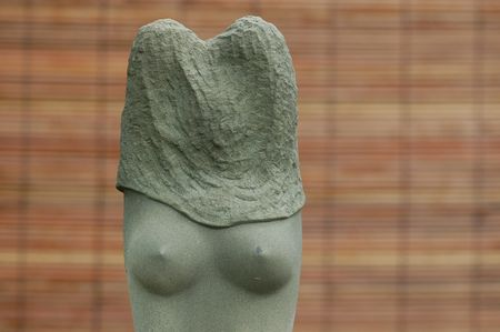 nipples: stone sculpture of woman nipples  Stock Photo