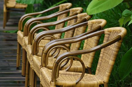 rattan chairs at the poolside                                  photo