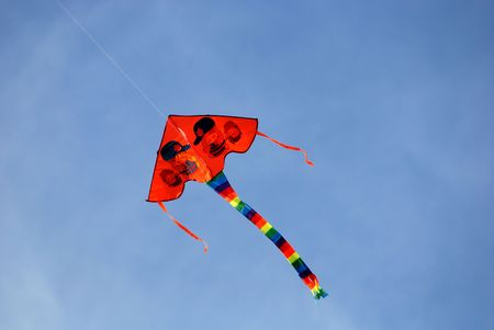 Colorful kites flying in the blue skies  Stock Photo