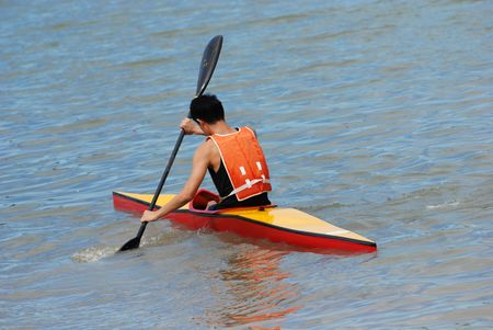 people practices canoeing in the sea