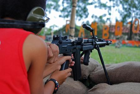 man testing the machine gun Stock Photo - 1576237