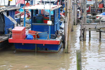 Fishing boat parked at the fishing village photo
