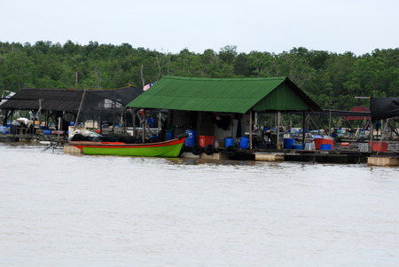 wooden hut: wooden hut and boat at the fishing farms
