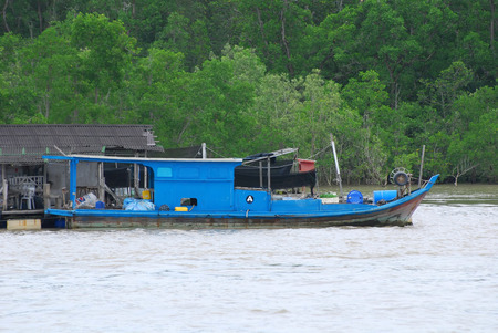 wooden hut and boat at the fishing farms photo
